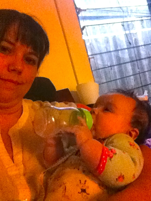 And holding her own bottle